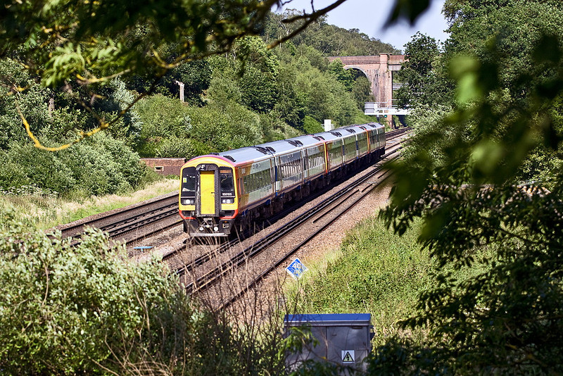 28th Jun 12:  159105 is leading on 1L49 the 16.20 Waterloo to Exeter. Seen here rushing down the slope between Winchfield and Hook