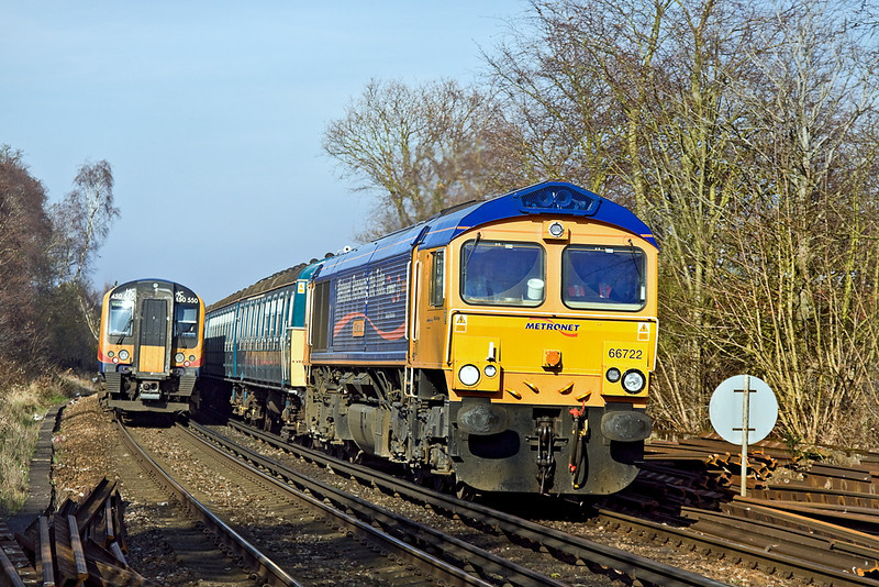 12th Mar 12: Metronet liveried 66722 is taking  4 VEP 3417 from Clapham Junction to Wimbledon Depot via Staines when pictured at Rusham Crossing on Prune Hill in Egham