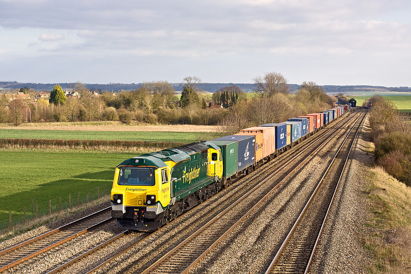20th Mar 12:  70019 roars away from Cholsey working 4M68 from Southampton to Birch Coppice