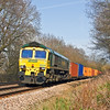 23rd Mar 12:   Returning to Southampton from Wentloog is 66533 hauling 4O51 about to cross Great Park Crossing in Mortimer