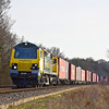 23rd Mar 12:  70018 heads north on 4M68 to Birch Coppice from Southampton.  The location is Danes Crossing in Grazeley.  With the clocks changing tomorrow the 23rd is the last day that the sun will be round far enough to get this shot.