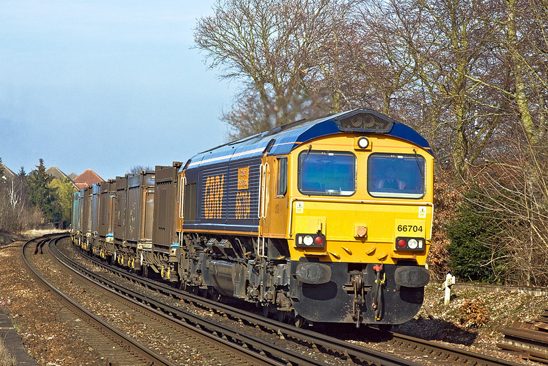 12th Mar 12:  The Mountfield to Southampton empty Gypsum Containers in the hands of 66704 at Rusham Crossing