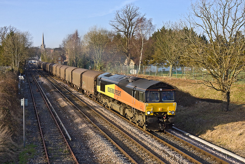 11th Mar 12:  In beautiful evening light 66846 takes the Guildford line away from Wokingham with 6O78 loaded steel from Margam to Dollands Moor