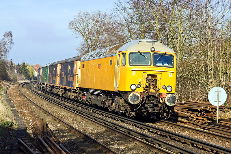 12th Mar 12:  An interesting convoy headed by 57312 working from Hoo Junction to Eastleigh is pictured at Rusham Crossing in Egham.  Thre other locos are  73206/204/136/109