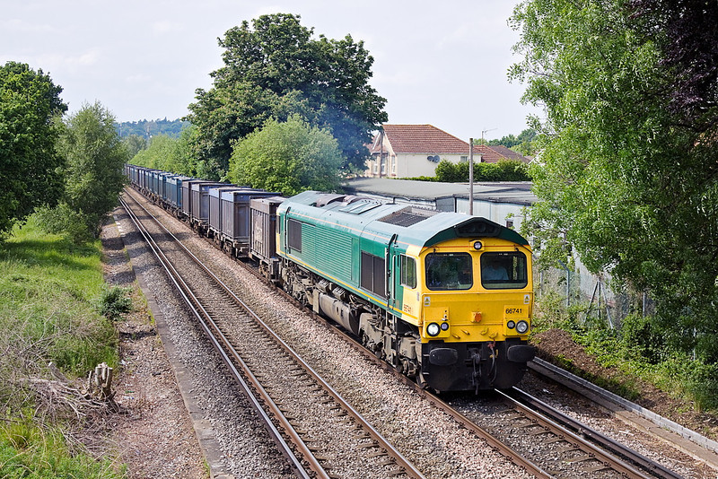 28th May 12:  Picking up speed across Addlestone Moor is Ex Freightliner 66581 now GBRF 66741 working 4Y19 empty Gypsum containers from Mountfield to Southampton
