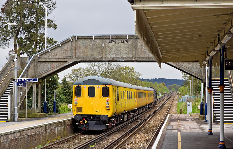 4th May 12:  Trailing through Bagshot is DBS 9701.  1Q14 is hauled by 37423 on the leg from Staines to Aldershot