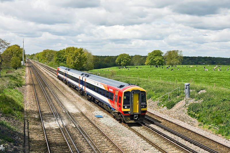 16th May 12:  159106 in some nice light  at Totters Lane as it heads to London  with the 10.48 from Salisbury
