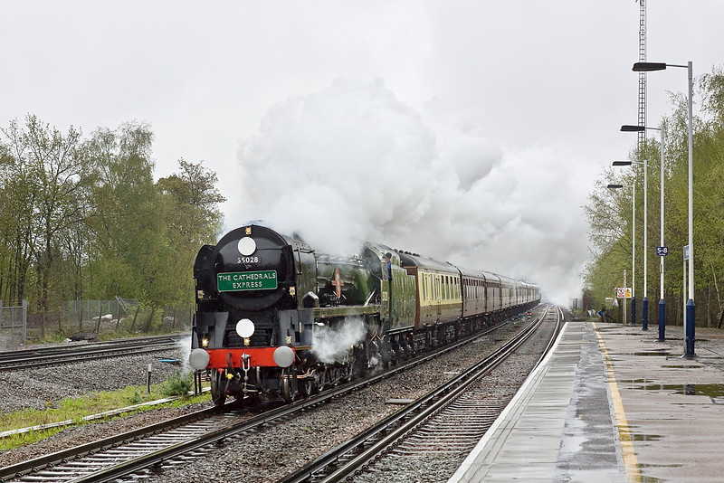3rd May 12:  Originally planned to use 34046 'Braunton' the day's Cathex to Exeter  is headed by 35028 'Clan Line'.  In heavy drizzle  the ensemble speeds through Winchfield