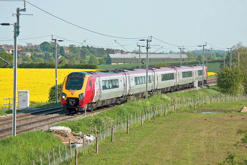 22nd May 12:  221116 is working 1D90 from Euston to Bangor, captured here on the Northampton Loop at Long Buckly