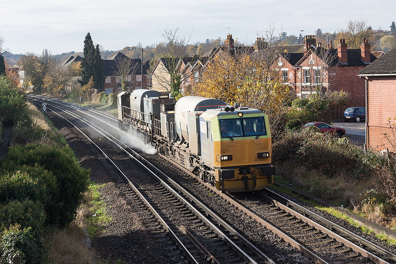 13th Nov 12: The  Effingham Junction pair DR98907 & 98957 or seen at Egham ot the Alton to Clapham leg of   3S82s itinery.
