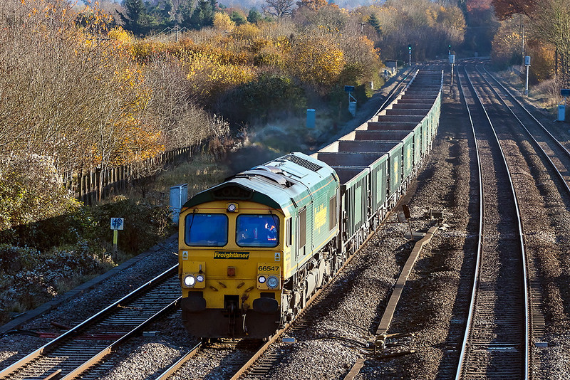14th Nov 12:  The Crawley to Stoke Gifford empty boxes (6V87) is powered by 66547 through Lower Basildon