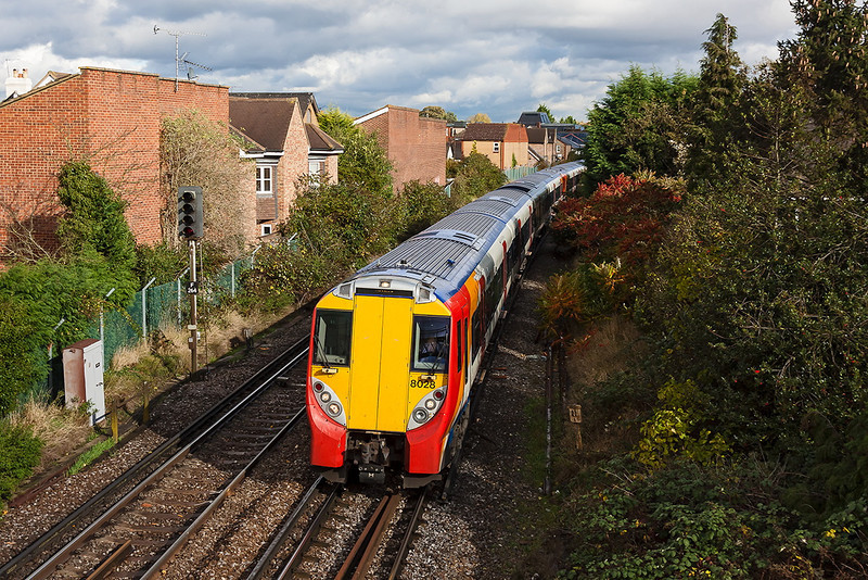 1st Nov 12:  458028 leads on the 12.20 from Waterloo to Reading.  2C33 is captured leaving Egham.