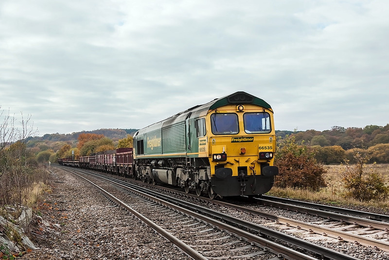 13th Nov 12:  DBS hire in from Freightliner 66535 approaches Rusham Crossing near Egham with 6Y41 departmental service from Eastleigh to Hoo Junction