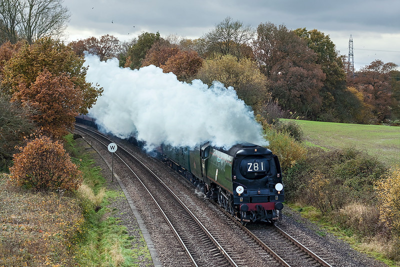 17th Nov 12:  Running late due to stalling earlier 34067 'Tangmere' is going very well as it roars under the Park Lane bridge in Silchester.  The Capital Christmas Express is running from Weymouth to Paddington