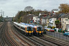 19th Nov 12:  444032 working 1W40 the 12.20 from Weymouth to Waterloo passes 450011 on the approach to Southampton