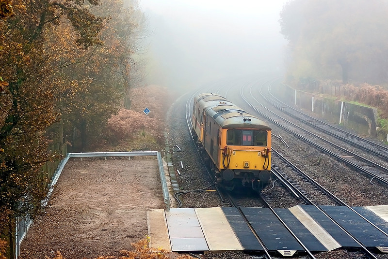 16th Nov 12:  Running as 0Y68 73205+204, one with a very flat tyre,  pass Curzon Bridge on a very misty day