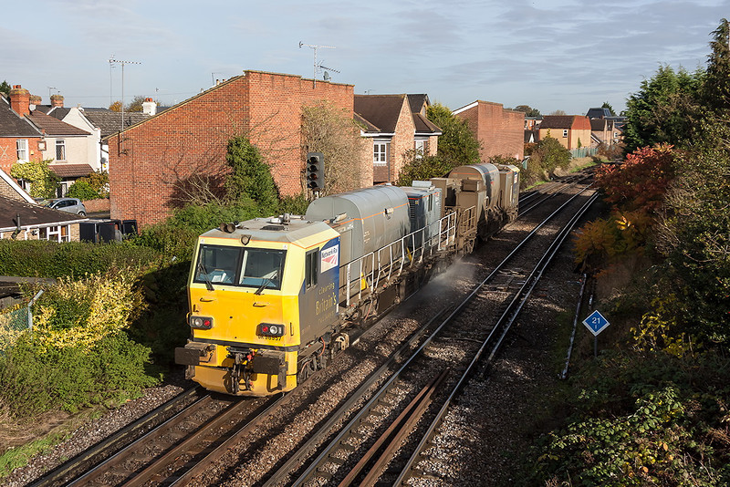 13th Nov 12: The  Effingham Junction pair DR98957 & 98907 are seen at Egham on the Alton to Clapham Junction  leg of   3S82s itinery.
