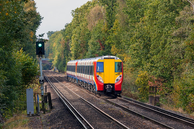 18th Oct 12:  Nearing Martins Heron and captured in a sunny gap in the tunnel of trees are 458010 & 8017 working 2C40 the 13.09 Reading to Waterloo.  This was taken as a test shot for the pair of 37s that were due to follow but of course the sun was then nowhere to be seen.