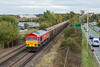 30th Oct 12:  Freight through Bracknell is a rare event but 7Z20 was booked to run today from Grain to Merehead.  Running slightly late 59204 brings the empties away from Bracknell beside the A329 at Amen Corner