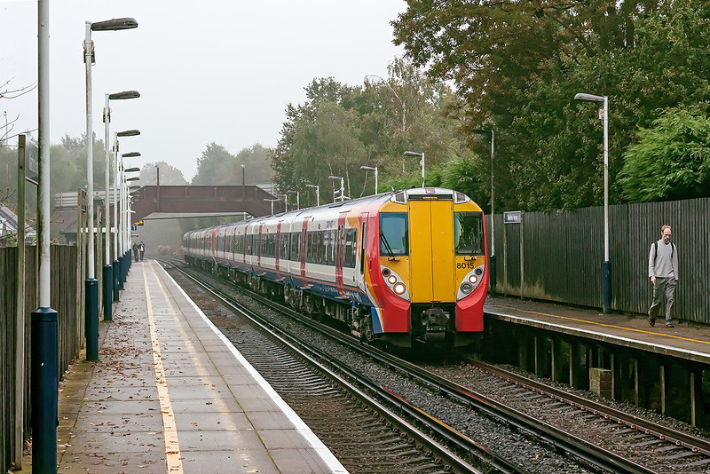 23th Oct 12:  On a very dank and dull morning the 09.50 from Waterloo to Reading (2C23) pulls into Martins Heron.