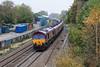 24th Oct 12:  Running past the site of Coalpit Heath station is 66060 in charge od 6E86 from Portbury to Ferrybridge