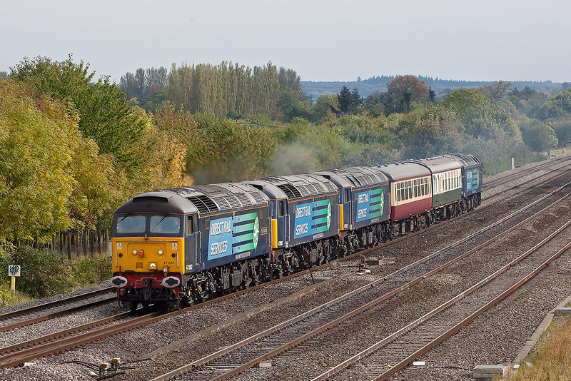 9th Oct 12:  It is unsual to have more coaches than locos but then 0Z54 probably should not have any at all.  47802/805/828 and at the rear 47818 are heading for Crewe from Eastleigh.  Captured here at Lower Basildon