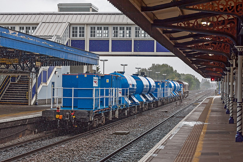 1st Oct 12:  In preparation for the new leaf fall season 66143 is taking two treatment sets from Acton to Bristol Barton Hill.  Captured in pouring rain passing through Twyford Station