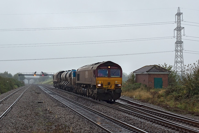 24th Oct 12:  66027 is leading on 3S59 the RHTT service from Moreton on Lugg to Weston Super Mare.  Captured at Pilning with 66126 on the rear.