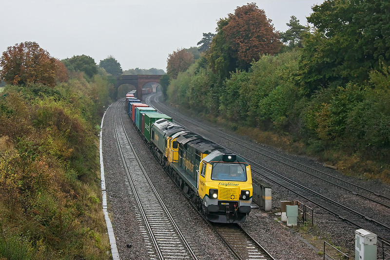 19th Oct 12:  On  foul afternoon 70020 with 66537 DIT are taking the 12.54 from Southampton Millbrook to Trafford Park through Purley on Thames