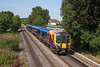 3rd Sep 12:  450563 is seen crossing Addlestone Moor with 2S29 the 11.22 from Waterloo to Weybridge