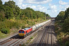19th Sep 12:  66097 runs through Twyford with empty hoppers from Hayes to Moreton on Lugg