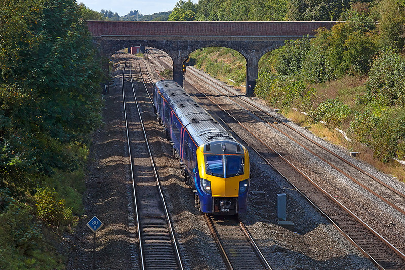 19th Sep 12:  The 09.54 Great Malvern to Paddington is running 9 minutes late as it passes through Ruscombe.  1P40 is formed of 180103