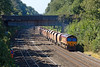 7th Sep 12:  66085 passes under Butts Hill Road in the Sonning Cutting with 6M20 from Whatley to St Pancras