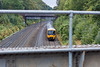 28th Sep 12:  Viewed through the handrail on the famous Duffield Road bridge in the Sonning Cutting is 165127 working 2P52 the 12.37 from Oxford to Paddington