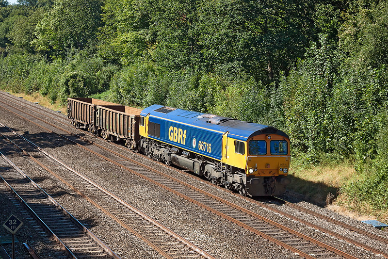 7th Sep 12:  66716 on the Up Relief through the Sonning Cutting with two boxes for use on the spoil trains  from the Cross Rail project.   6O27 is running from Cardiff Todal to Tonbridge .
