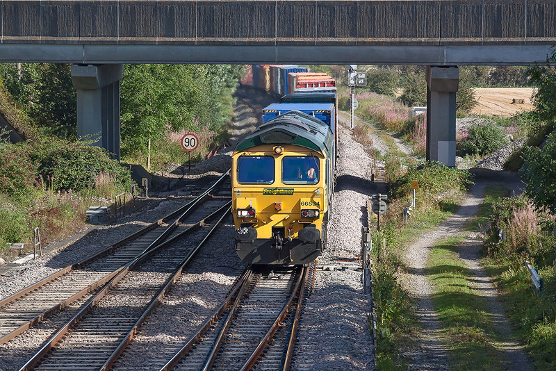 5th Sep 12:  4O14 is the 07.00 from Birch Coppice to Southampton, captured here in the hands of 66534 as it runs through Didcot North Junction
