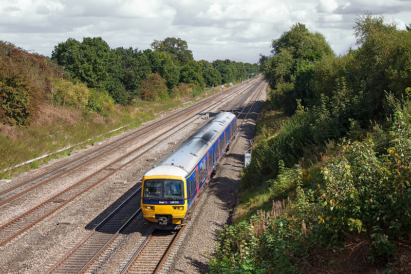 19th Sep 12:  The 12.21 from Paddington to Great Malvern races down on the Main Line through Ruscombe.  1W32 is formed of 166219