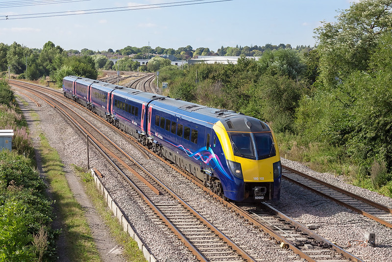 5th Sep 12:  180102 is working 1W21 the 09.21 from Padington to Worcester Foregate Street.  Seen here art Didcot North Junction