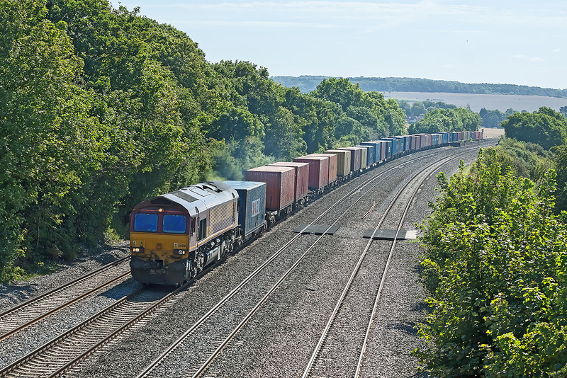 5th Sep 12:  66201 is in charge of 4M66 from Southampton to Birch Coppice,  Pitured from Reading Road in Cholsey