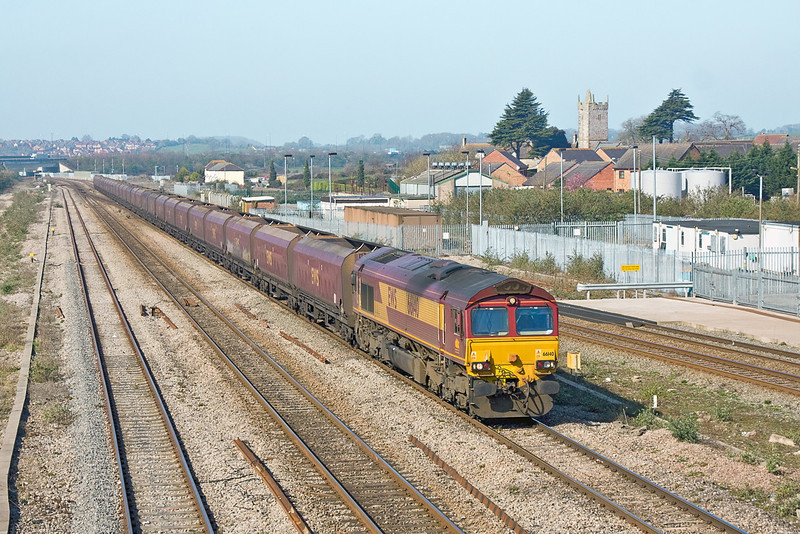 27th Mar 12: With a very long rake of empty HTA hoppers 66140 takes the Gloucester line at Severn Tunnel Junction with  4E66 from Margam to Redcar