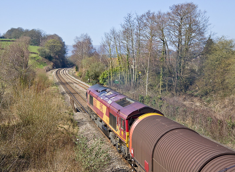 27th Mar 12:  The Margam to Dee Marsh steeler in the hands of 66050 climbs through Ponthir