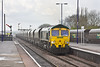 26th Apr 12:  As the rain again falls 66561 eastbound through Barnetby with coal empties from Scunthorpe to Immingham