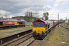 26th Apr 12:  66047 on 6H15 from Immingham to Drax passes 66207 at Barnetby