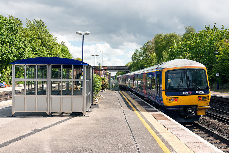16th May 13:  166212 forming the 10.38 from Bedwyn to Paddington passing he new CrossRail shelter at Twyford