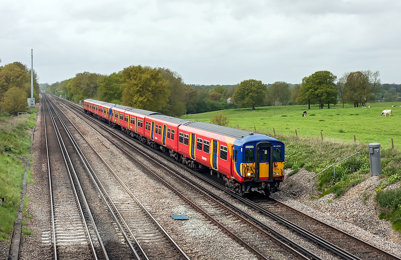 14th May 13:  Working to Waterloo from Basingstoke Barton Hill Carriage Siding as 5Z90 are 455736 & 455872.  Pictured from the bridge in Totters Lane between Hook and Winchfield