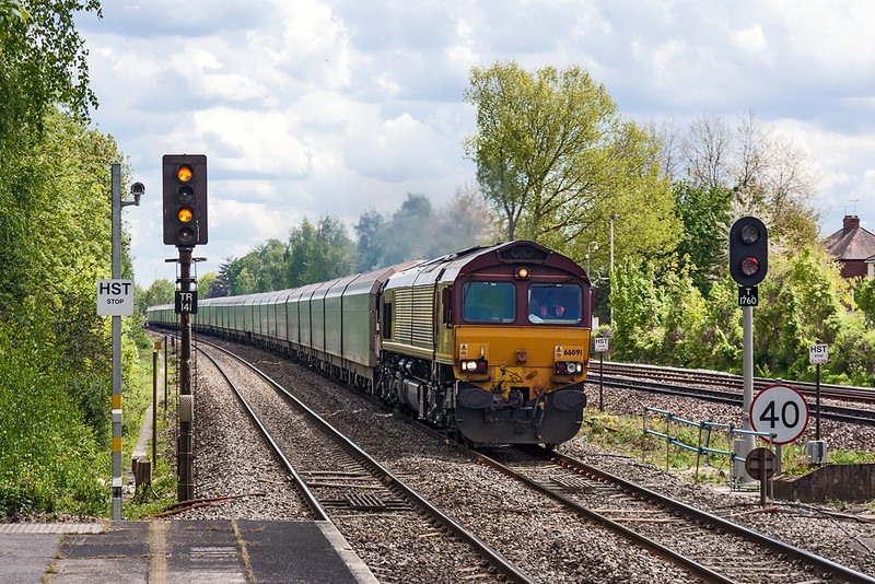 16th May 13:  The Southampton Eastern Docks to Castle Bromwich car carriers pass  through Tilehurst behind 66091