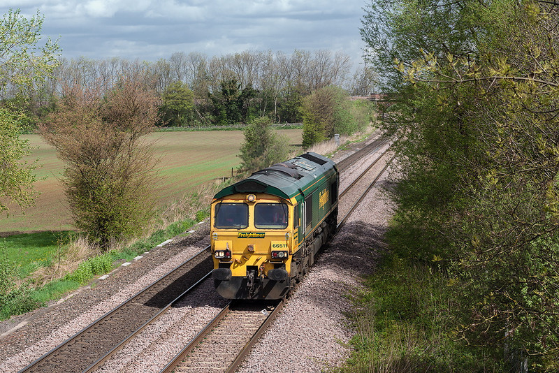 9th May 13:  With the bridge carrying the Leeds to Selby line just visible 66511 rumbles south towards Milford Junction