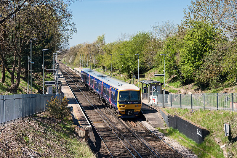 1st May 13:  First Great Western 166208 runs through Winnersh with the 14.04 from Reading to Redhill