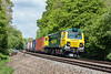 25th May 13:  Freshly back in traffic following it disastrous fire is 70018.  Captured between Mortimer and Bramley working 4O59 from Wentloog to Southampton Maritime