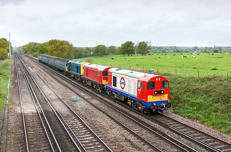 14th May 13:  Taking the 4VEP back to Clapham Junction following the Swanage Diesel Gala are 20227, 20189 in Underground & London Transport livery and 20142 in early BR livery.  Captured here on a dull and damp lunch time at Totters Lane